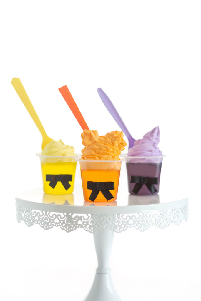 three hocus pocus themed gelatin cups, decorated in likeness of the three hocus pocus witches