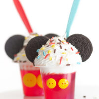 mickey mouse desserts for a part. Gelatin cups topped with whipped cream, sprinkles and OREO cookie ears.