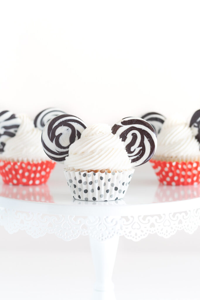 mickey mouse themed cupcakes served on a cake stand