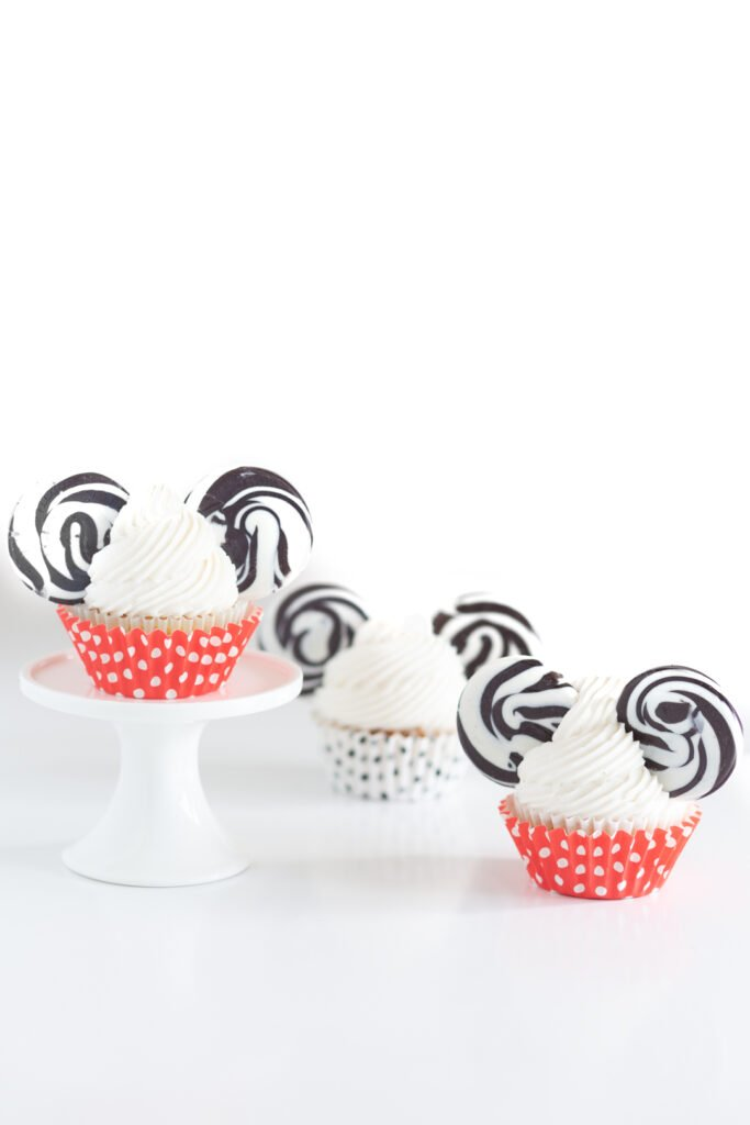 Mickey mouse cupcakes with black swirl lollipop ears. Red and white polkadot and black polka dot cupcake liners