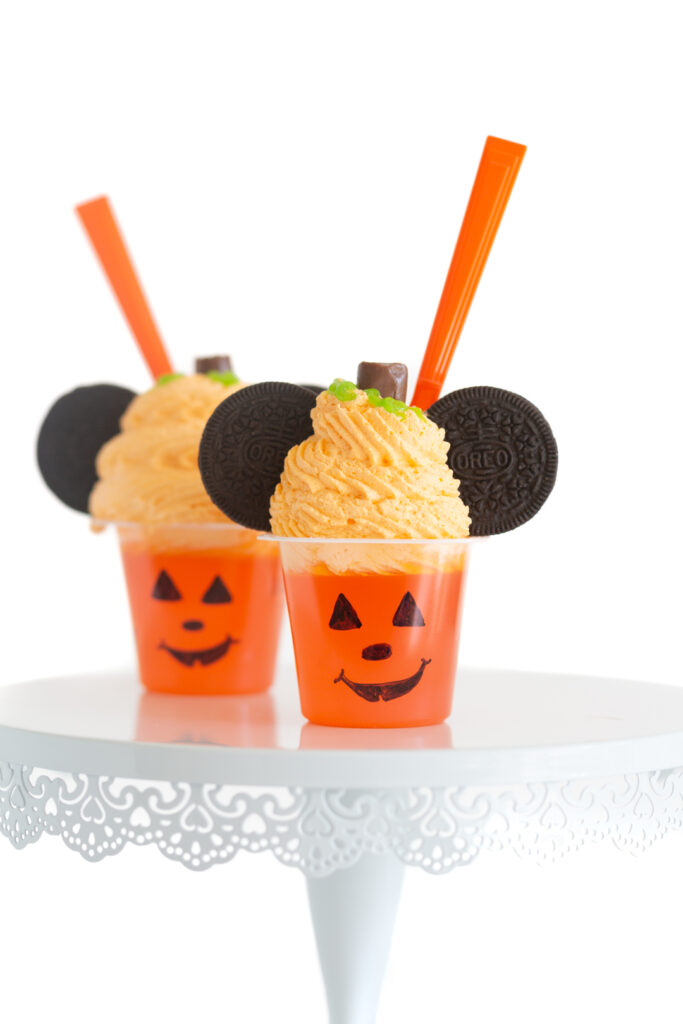 gelatin cups decorated like pumpkin mickey mouse treats Oreo cookies for mickey mouse ears.