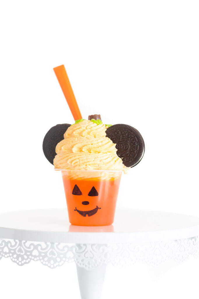 cute halloween mickey mouse inspired treat. Pumpkin colored gelatin treat decorated like a mickey mouse pumpkin