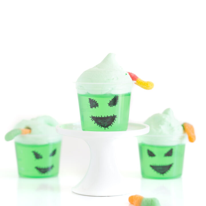 Oogie boogie decorated single jello cups with face drawn on with a black sharpie.