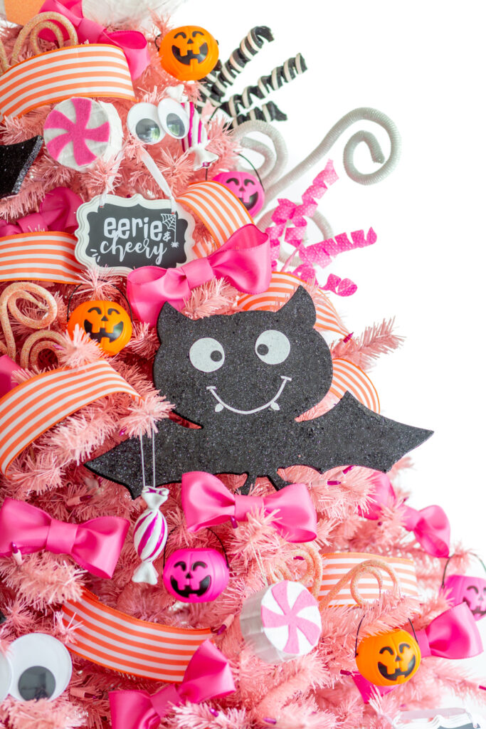 pink halloween tree with cute bats, mini jackolantern buckets as ornaments, fluffy pink bows and coral striped ribbon