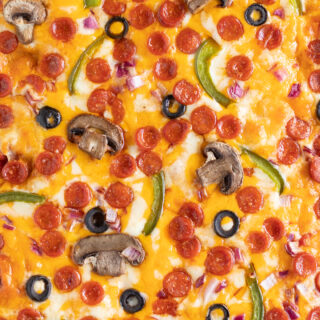 up close view of top of pizza showing only melted cheese and toasty mini pepperoni