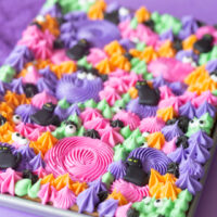 angled photo of half baking sheet cookies loaded with tinted buttercream frosting